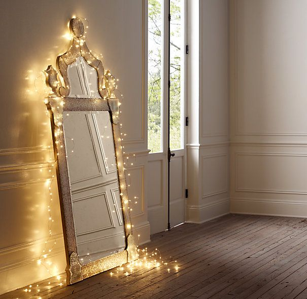 Starry Starry String Lights! • Year Round Home Decor using Christmas lights or firefly lights. • Tons of Ideas and Tutorials! Including, from 'restoration hardware', this idea using firefly lights around a mirror.