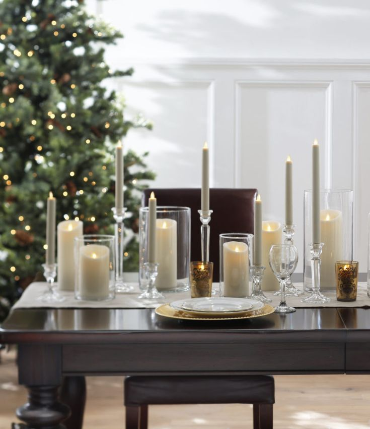 Easy Elegant Flameless Candle Christmas Centerpiece Ideas With Images Candles Pillar Candle Centerpieces Christmas Table Centerpieces