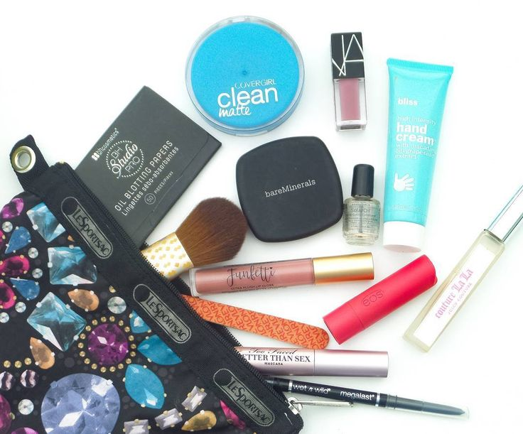 """Its Fri-yay! Heres a little """"Whats in my makeup bag"""" post...well this is the abridged version In real life I keep like 3 chapsticks 4 lipsticks and like 5 pounds of old granny mints in my purse/makeup bag Whats the one product you cant live home without? Id love to know! . . . #friday #friyay #tgif #lesportsac #bhcosmetics #covergirl #nars #narcissist #bareminerals #bliss #revlon #ecotools #toofaced #eos #lipbalm #juicycouture #wetnwildbeauty #affordablemakeup #drugstoremakeup #makeupbag…"""