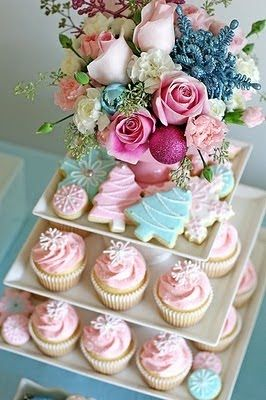 Pastel cupcakes and cookies topped with flowers