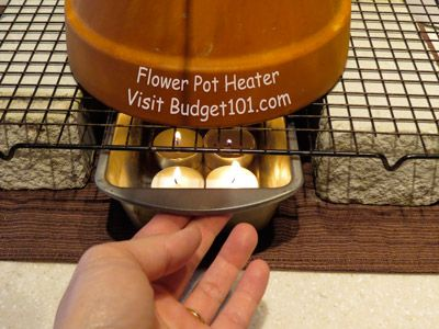 A flower pot heater. 4 tea lights and 2 clay pots. Great idea in an emergency.