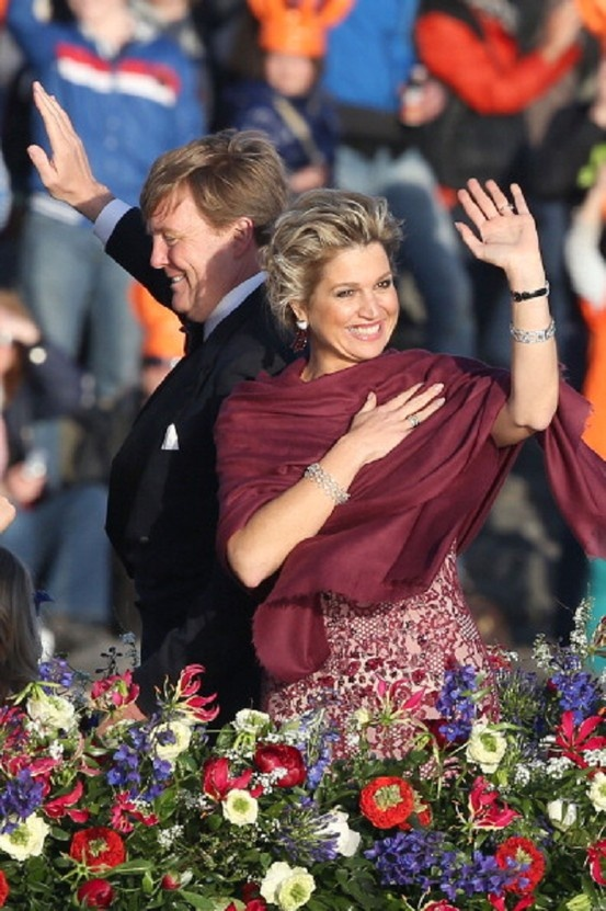 King Willem Alexander and Queen Maxima are seen aboard the King's boat for the water pageant to celebrate the inauguration of King Willem of the Netherlands