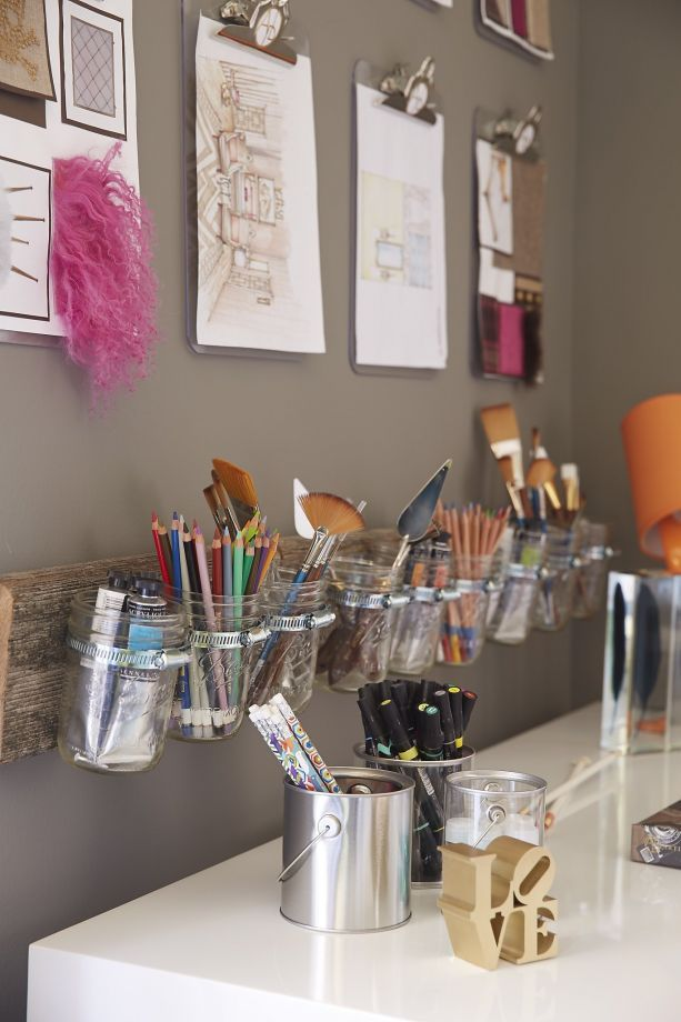 Tineke Triggs designed a room for a young pre-teen artist. Using paint as her inspiration, Triggs splattered the ceiling with color, chose a rug that looks like a watercolor painting and designed a desk to look like dripping paint. Clever storage tip: Triggs affixed mason jars to a piece of wood and hung it over the desk. Photo: Philip Harvey