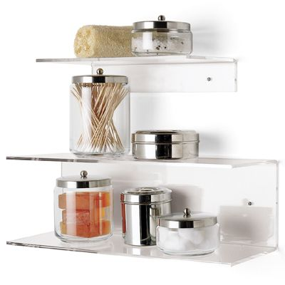 This is similar to what I want to do in our guest bathroom - but preferably with white/chrome shelving to match the other bathroom fixtures. But I love all the containers holding things like cotton balls and soap.