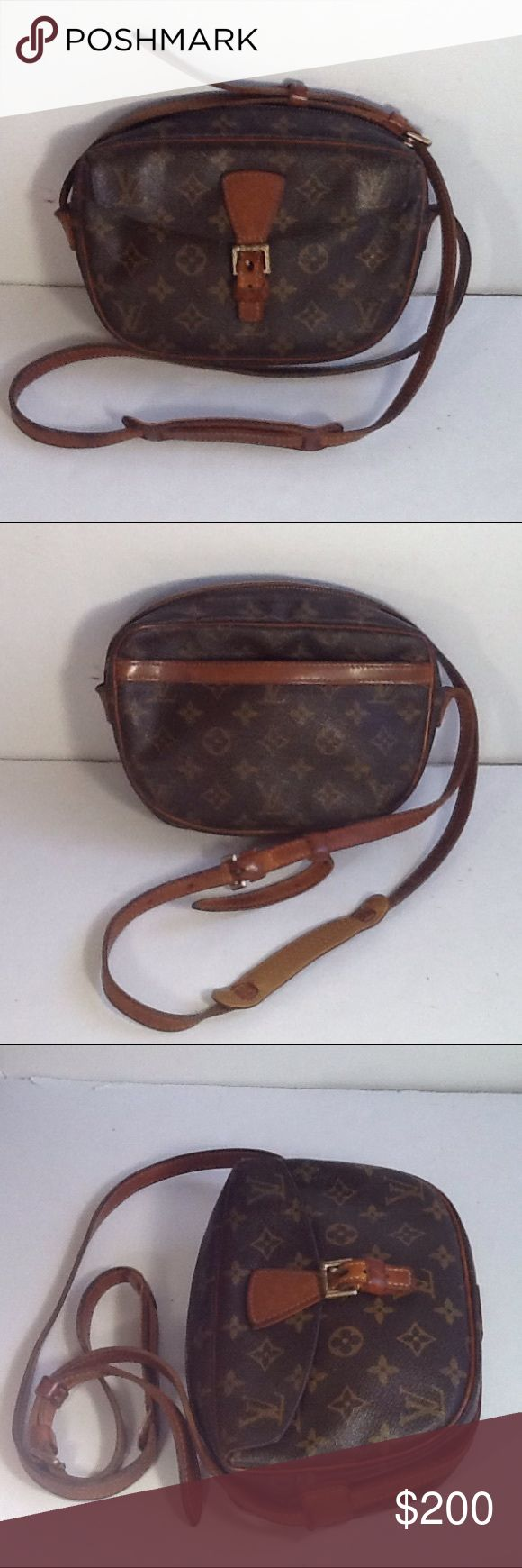 Authentic Louis Vuitton Jeune Fille Monogram Bag. Some light sticky are inside the pockets. The inside zipper pull tab was replaced. The bag was made in the USA with a date code SD 0162. Some light ink stains are inside the bag. The handle and leather showed signs of used. The dimension is 9, 6 and 2.5 Louis Vuitton Bags Crossbody Bags