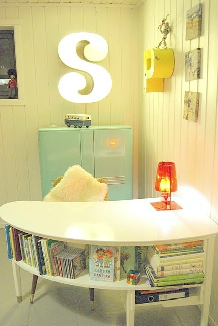 This would be so fun for my studio! Replace the children's books with design books - that'd be wonderful