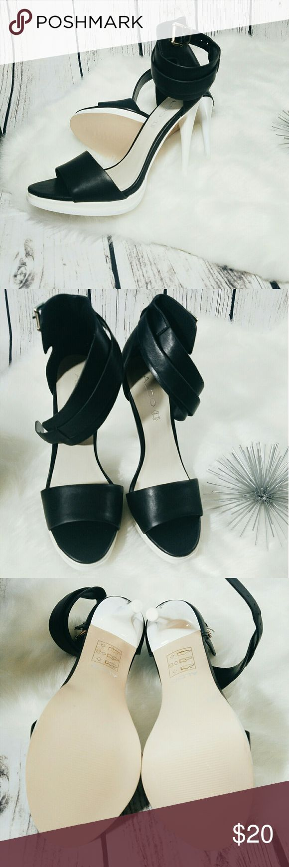 Black and and white strappy sandal from Aldo. This black and white shoe Sports an Ankle strap white heel and is really beautiful baby soft leather. Silver detailing. Brand new shoe never worn. This shoe will ship 2 to 4 days after your purchase. Thank you. Aldo Shoes Sandals
