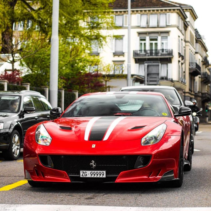 Ferrari F12 TDF painted in Rosso Fuoco w/ White and Black racing stripes Photo taken by: @intercars on Instagram