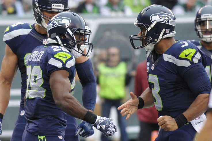 Wilson sharp, throws 3 TDs in Seahawks' 27-17 win over Jets
