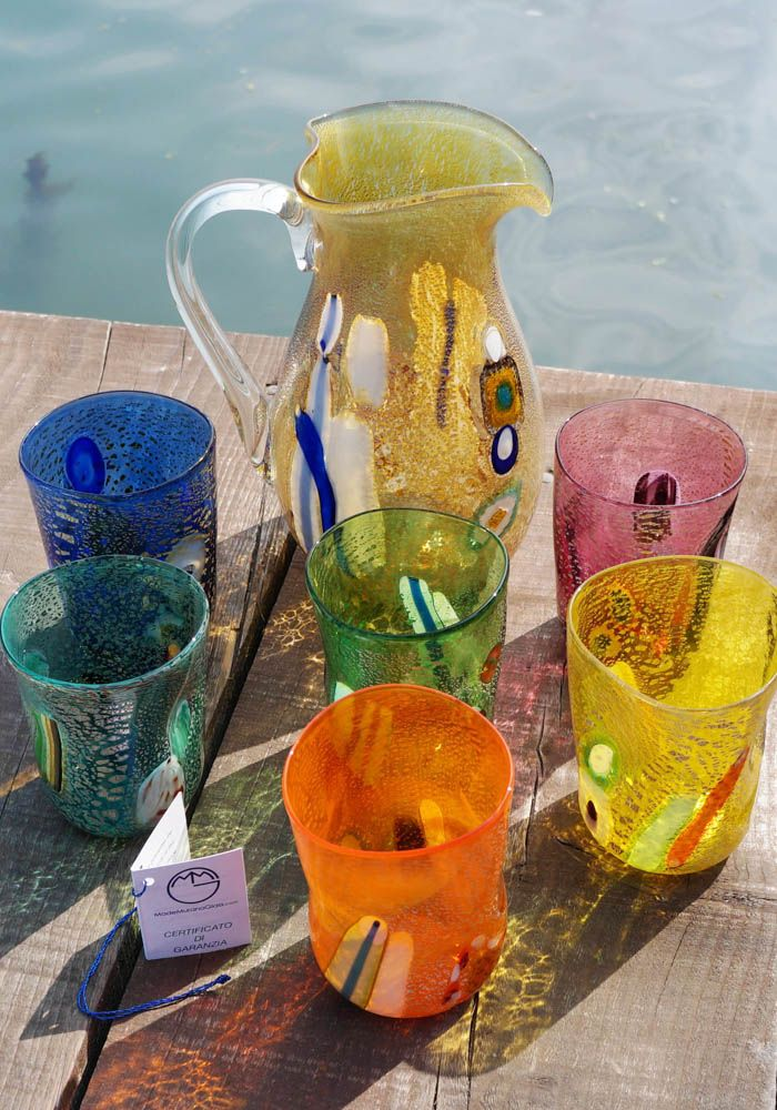 "Magnificent series of 6 #Murano #glasses and #jug in #Murano #glass. This set is called ""#GOTI DE FORNASA"". Tradition wants that the #Murano #glass #master with his employees did these #Murano #glasses to drink during work breaks.--- #Bicchieri e #caraffa in #vetro di #Murano decorati con #Murrina e #argento."