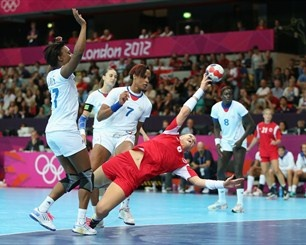 Heidi Loke of Norway scores a goal in the women's Handball against France