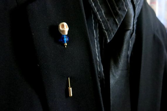 A splash of rich blue and a grinning skull pin for your jacket lapels, coats, hats, ties, scarves, ascots, cravats...