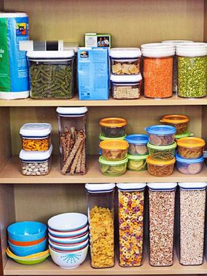 Allocate a few shelves solely for kids' (big or small) go-to favorites repackaged in see-thru containers. To make packing lunch a snap, divide large bags of pretzels, chips etc. into single-serving containers.