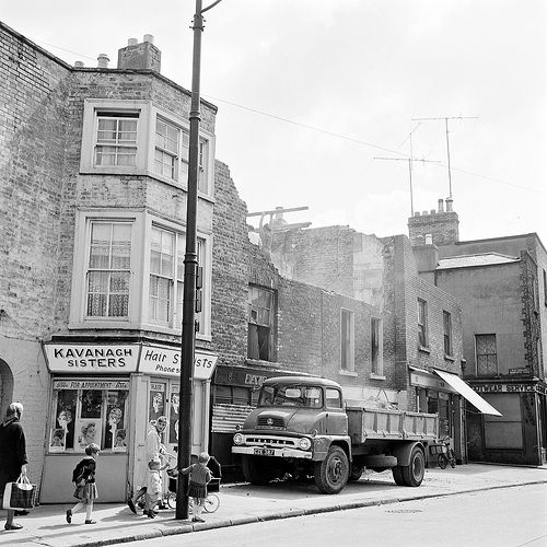 """Demolition: """"Starting in the 1980s Kelly's Corner was re-developed. Old Camden Street and Charlotte Street disappeared and the ruined buildings there made way for the Camden Court Hotel. The north side of Harcourt road was developed, Stein's the opticians being the last to go in the first phase, and Gleeson's pub in the second."""""""