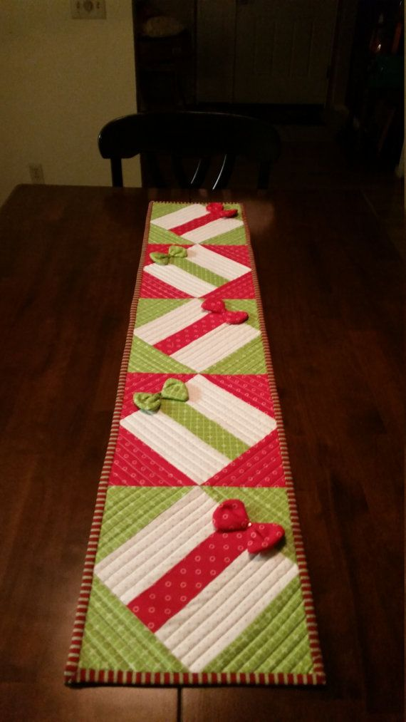 This is a cute quilted table runner, 45x12. The bows actually sparkle under lights as they have rhinestones. There are 2 place mats to match. If