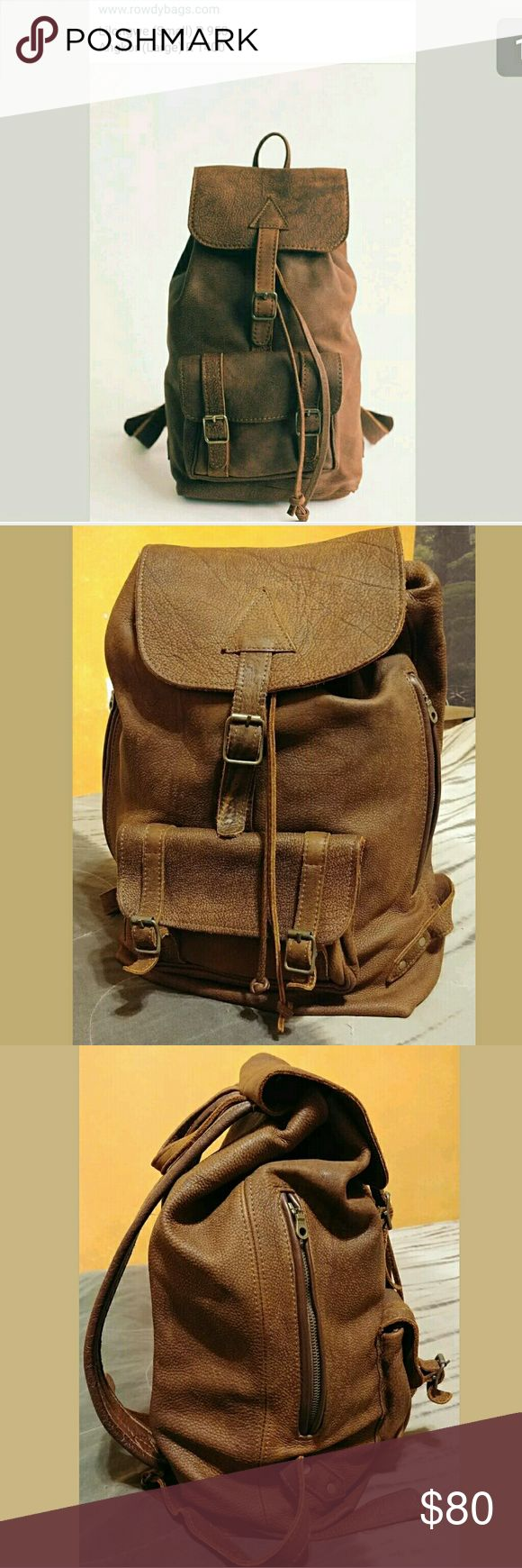"Rowdy Leather Rucksack Handmade rugged leather Excellent condition Rowdy Bags Large leather Rucksack. The color is called Worn Brown. The bag is made of unlined heavy duty softened nubuck and features:  -Drawstring closure with flap & buckle  -Buckle closure front pocket  -Two zippered, leather-lined side pockets  -Interior slip pocket  -Rear cotton-lined laptop zip pocket (fits up to a 13"" laptop)  -Adjustable straps and top loop  -Lifetime Guarantee  -Measurements:  12.5"" length  20""…"
