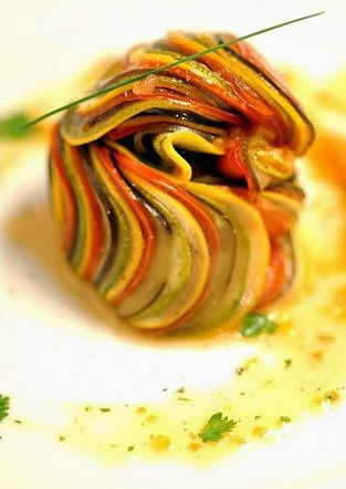 Confit Byaldi (Ratatouille from the movie) - one of the more complex dishes I've ever attempted, but worth the effort.