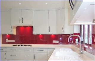 Red Tile Backsplash Gives This Sterile Kitchen A Pop Of Color And Adds Life