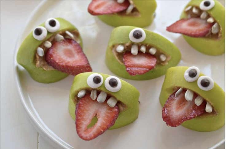 Apple Slice Monsters! Slice apples, cut out mouth, use caramel as filling and glue, attach strawberry tongue. Candy eyes and teeth can be bought or made with sugar or marzipan and food dye.
