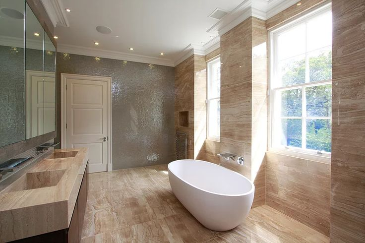 Travertine marble bathroom by Macassar Properties - London investment and development company