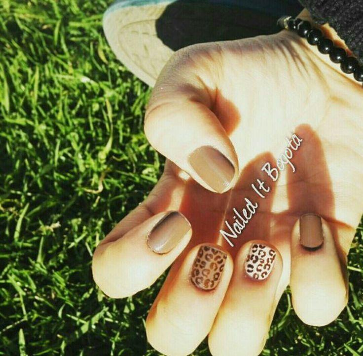 Brown animal print nail design