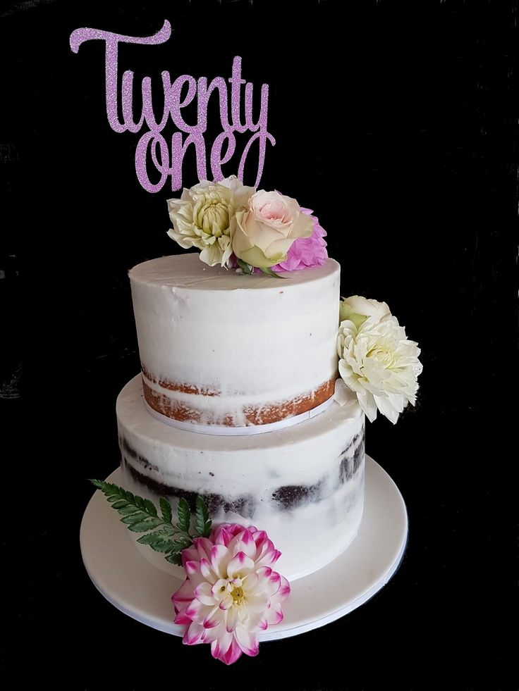 Eliza's 21st was celebrated with this cake at her high tea party. Top tier is lemon mud cake with white chocolate ganache and the bottom tier is chocolate mud cake with cookie dough frosting. the cakes were finished with white buttercream to give a semi-naked look and decorated with blooms from The Flower House.