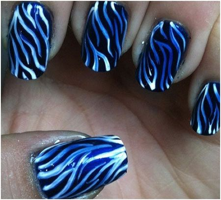 This nail art looks a little tough but it is in-fact quite easy to do. For this just paint your nails black and add zebra stripes with white and blue.