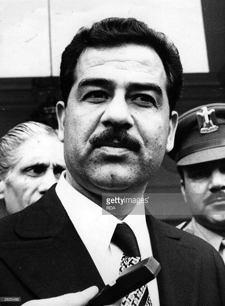 1980: The President of Iraq Saddam Hussein on a visit to France.