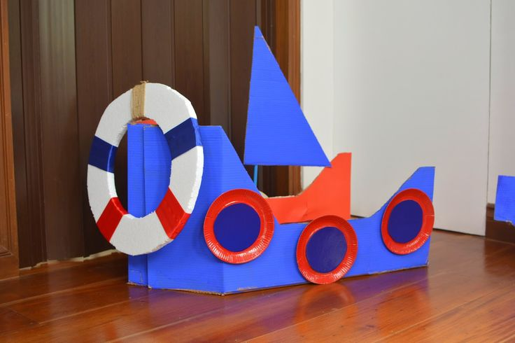 DIY cardboard box boat for a nautical themed party #cardboardbox #diyboat #diy #nauticaltheme