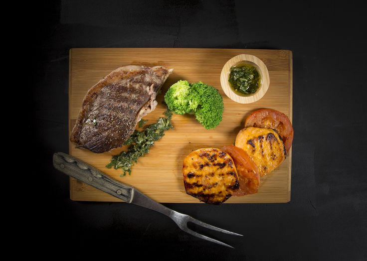Rump Steak served with Steamed Broccoli, Grilled Tomato finished with a fresh Herb Dressing