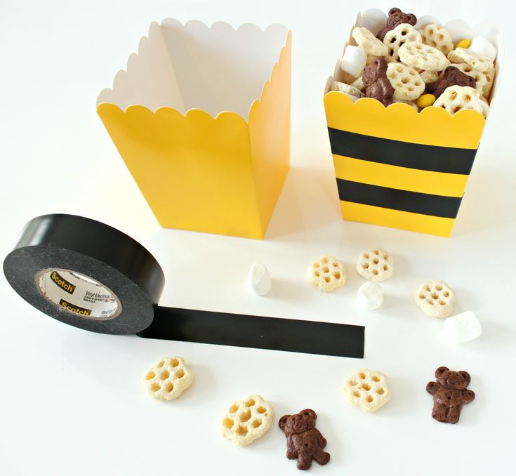 Honeycomb Party Mix is the perfect snack at a bee party. Combine Honeycomb cereal, mini marshmallows, chocolate Teddy Grahams and mini yellow candies. Yum!