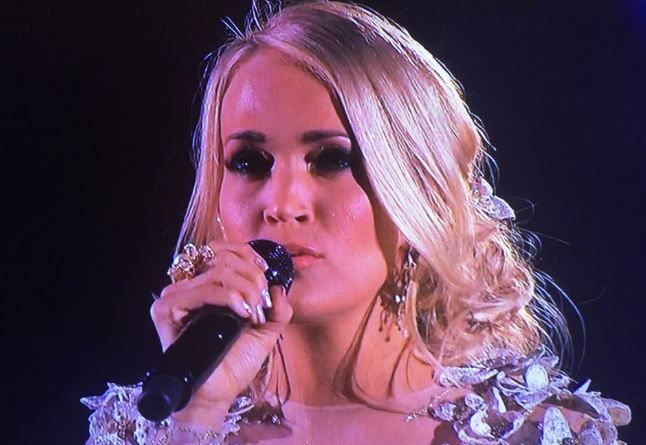 """Carrie Underwood took a break from hosting the 2017 CMA Awards on Wednesday to perform """"Softly And Tenderly."""" Watch the video below! As Gossip Cop reported at the time, Underwood performed """"Dirty Laundry"""" at the 2016 CMA Awards. The track was from her 2015 album Storyteller, which debuted at numb"""
