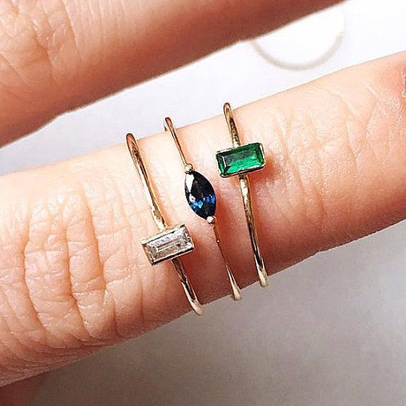 Dainty gemstone rings with a marquise-cut sapphire and a baguette-cut emerald and diamond