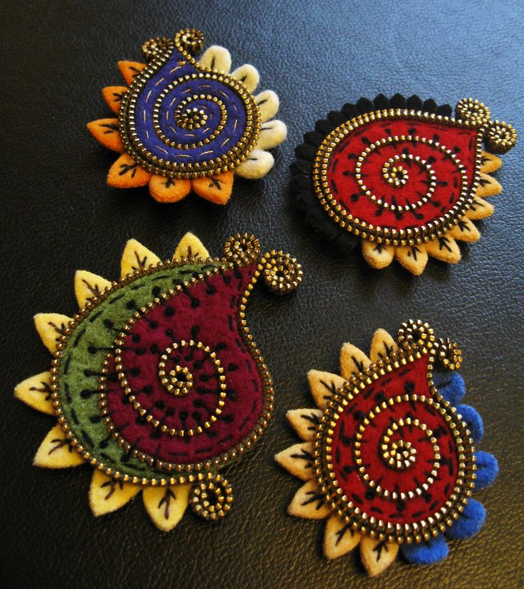 Felt, bead and thread brooches by Odile Gova on Flickr