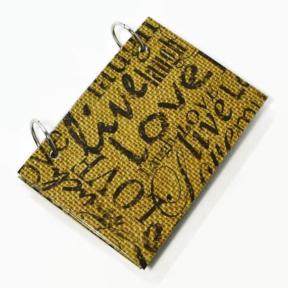 Hand stamped words on burlap pattern on the outside cover of this index card holder with a solid black inside cover. The index card binder address book for writing your contacts and phone numbers. This index card binder is created with care using sturdy chipboard covered with designer papers. The binder is then protected with a glossy laminate applied over top and then bound together with two 1 book binder rings. Included are 50 - lined index note cards and 5 dividers to separate your…
