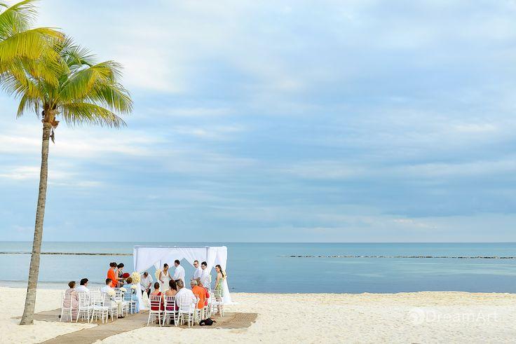 Lovely wedding ceremony against stormy sky at the @gvrivieramaya. Photo courtesy of #DreamArtPhotography.