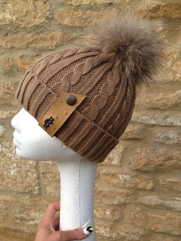 The chunky knit camel bobble hat with Raccoon fur Pom Pom looking stunning - available for just £39 www.hollandcooper.com #hollandcooper