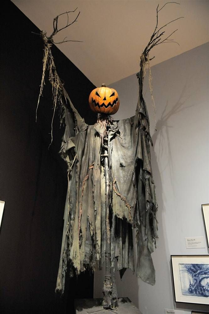 awesome pumpkin scare crow use chicken wire and branches for body and drape black plastic bags for cloak this is burtons scarecrow at the moma from