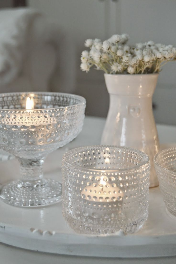 Candle scape with crystal and white.
