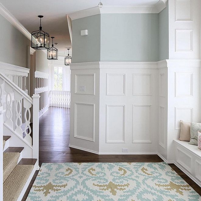 Hallway features wainscoting and molding walls and a window seat.