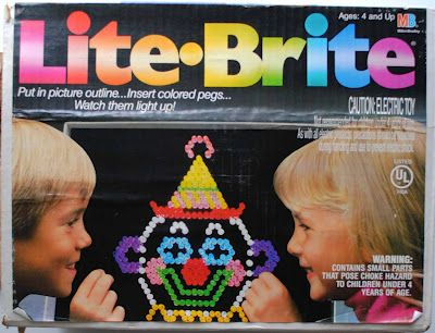 Lite-Brite!!!!! I remember sweating in front of this during those 1980s summers because of how warm the lightbulb would get.  I loved mine!