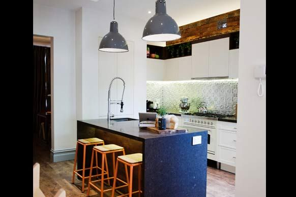 I will have industral light over my kitchen bench, i just live the exposed brick as well