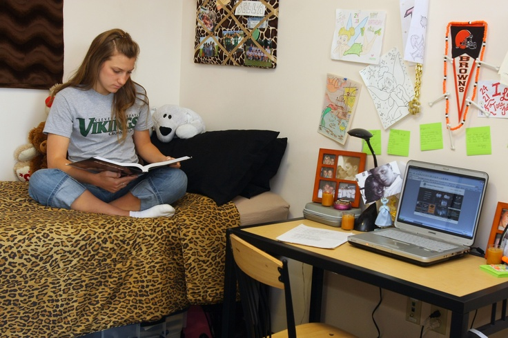 A Student At Cleveland State University Studying In Her Dorm Room While  Wearing A CSU Cross Part 38