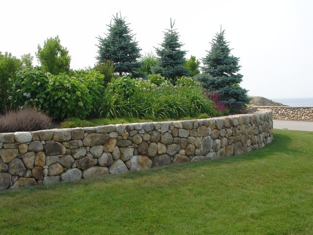 Curved stone wall dry no concrete construction stone for Curved garden wall ideas