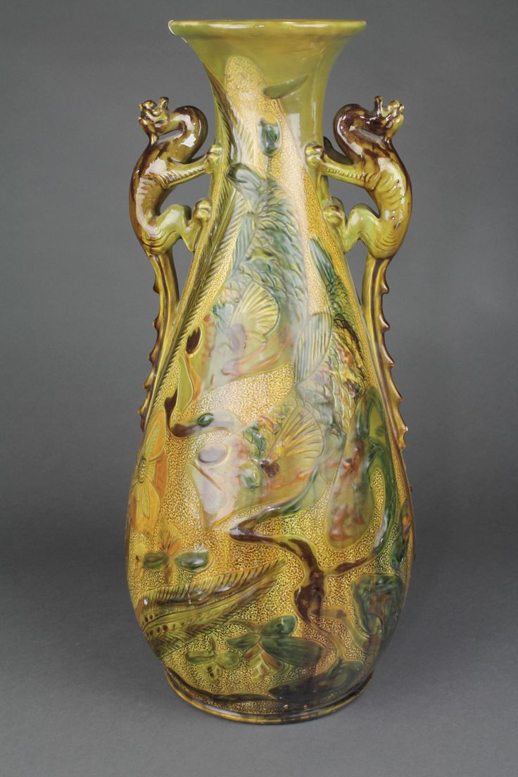 """Lot 129, A Brannam Barum Art Nouveau oviform vase with stylised dragon handles decorated with flowers and leaves 20""""  sold for £130"""