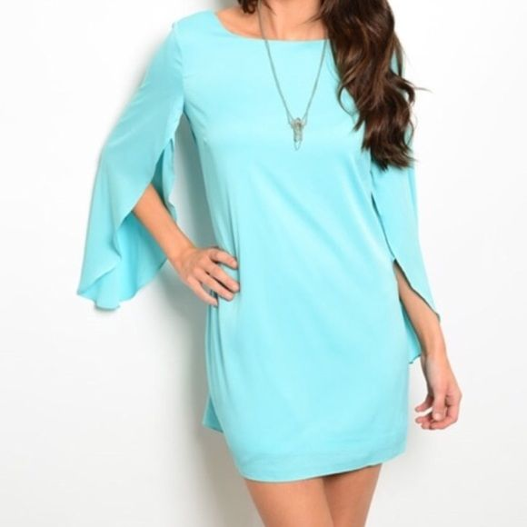 Aqua dress 100% polyester  	 This woven shift dress features 3/4 sleeves with slitted hem and has a crew neckline.  Available in Small, Medium (sold out of large, I can order more if wanted) MODEL IS WEARING THE EXACT PRODUCT   20% off all bundles of 3+ items   •Comment below what size you'd like & I'll make a separate listing for you to purchase• Dresses