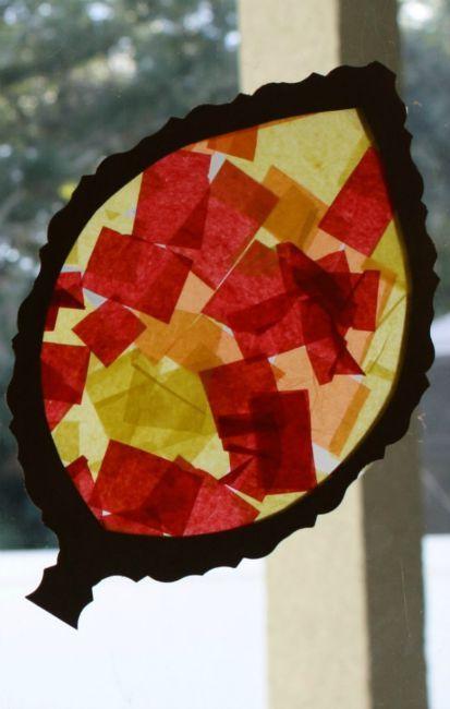 Fall crafts for kids - tissue paper leaf sun catcher