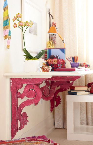 Desk area for girls room - You don't need a gallon of paint to make a bold statement. Instead, target a small architectural detail, like the reclaimed brackets supporting this DIY desk. Then create a colour motif in the surrounding vignette by layering in accessories in matching tones.