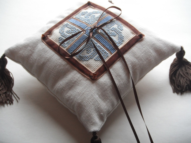Celtic Knotwork Cross-Stitched Linen Ring Pillow for your Celtic or Mediaeval Wedding. $55.00, via Etsy.