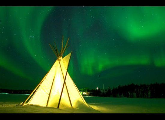 Northern Lights and illuminated Teepee in Yellowknife, Northwest Territories     Why Go: Areas around pristine Lake Superior in Ontario and Northern Canada's tundra back-country are prime viewing spots. Head to the town of Whitehorse within the Yukon Territory to best see the swirling lights. Sometimes, the glowing sky can be seen as far south as the American border, but stick to Canada's vast wilderness for your front row seats.